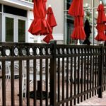 Flattop Black Railing with circles around Patio