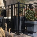 Flattop with Spear Picket Black Railing around Porch