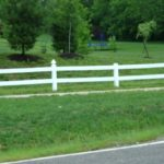 White Two Rail Ranch Rail Fence with Alternating French Gothic Post Caps