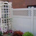 White PVC Privacy with Diagonal Lattice & a Custom Arbor