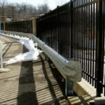 Guard Rail Next to Aluminum Fence